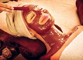 Chocolate Luxury Spa. Facial Mask. Spa therapy for young woman with cosmetic mask at beauty salon. Wellness. Chocolate Mask Facial Spa. Chocolate Treatments. Beauty Spa Salon  poster