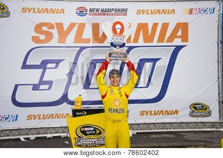 Loudon, NH - Sep 21, 2014:  Joey Logano (22) wins the Sylvania 300 at New Hampshire Motor Speedway in Loudon, NH.