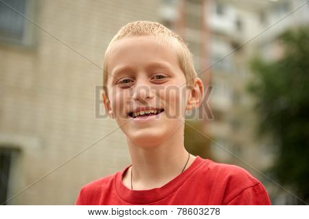 Ten Year Old Boy Having Fun Outdoors Smiling