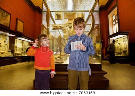 Boy And Little Girl At Excursion In Historical Museum