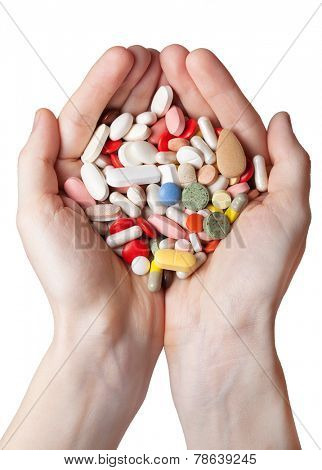 hands with pills and drug isolated on white background