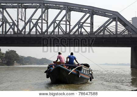 KOLKATA, INDIA - FEBRUARY 2014: Bridge across the river, Vivekananda Setu. It links the city of Howrah, at Bally, to its twin city of Kolkata, at Dakshineswar.