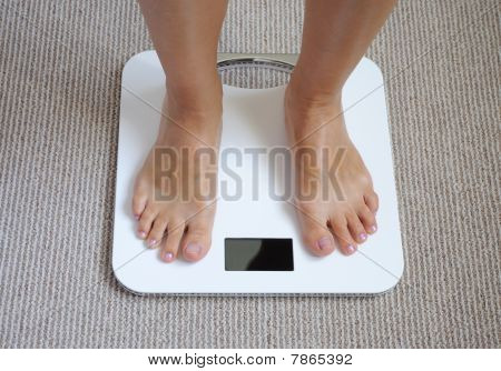 Female Feet On Scale