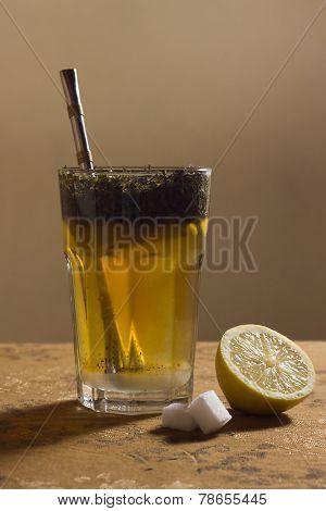 Serving A Glass Of Tea