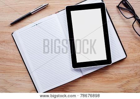 Flower Pot, Glasses, Ballpoint Pen And Notebook On The Desktop