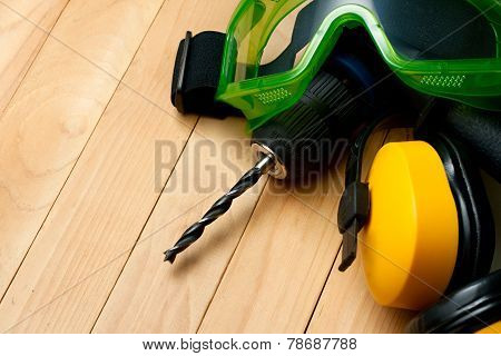 Handdrill, Earphones And Goggles