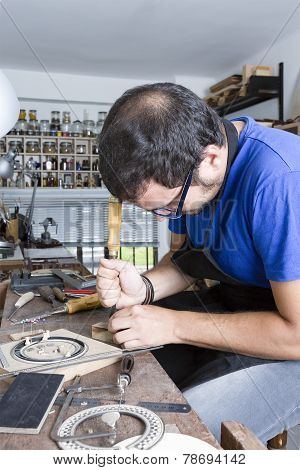 Luthier Working A Guitar Rosette