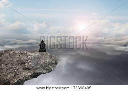Businessman Sitting On Cliff With Natural Sky Daylight Cloudscape