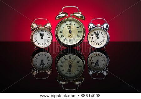 Group Of Alarm Clocks, Red Background