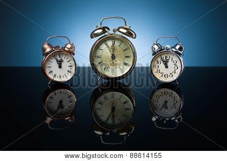 Group Of Alarm Clocks, Blue Background