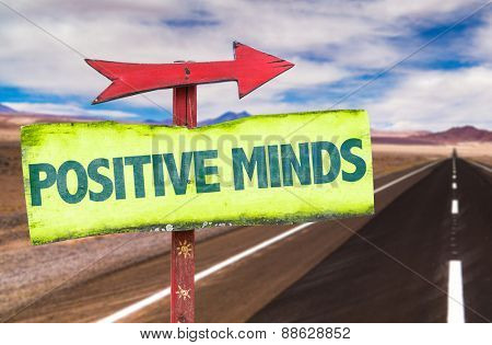 Positive Minds sign with road background