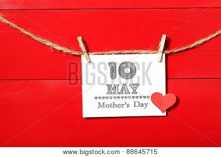 May 10th Mothers Day card with small red heart hanging with clothespins poster
