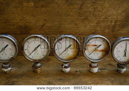 Old pressure gauge or damage pressure gauge of oil and gas industry on wooden background, Equipment