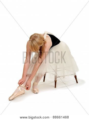 Ballerina Preparing Pointe Shoes
