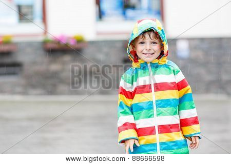 Little Blond Kid Boy Walking With Big Umbrella Outdoors
