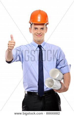 Construction Worker Holding Blueprints And Giving Thumbs-up