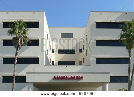 exterior of hospital emergency entrance against clear blue sky poster