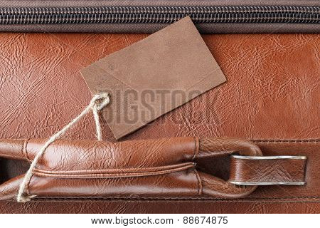 Leather tag on leather travel case
