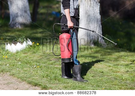 Young Man Holding Spray For Gardening