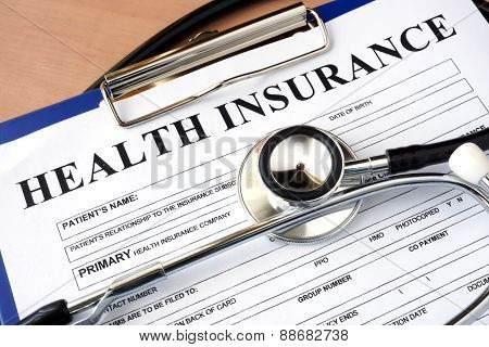 Health insurance form with stethoscope.