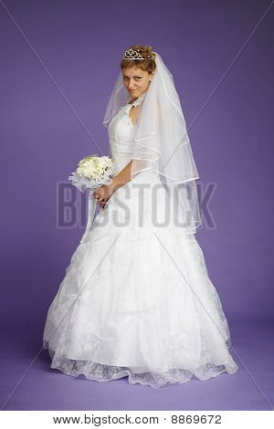 Young Beautiful Bride In White Dress