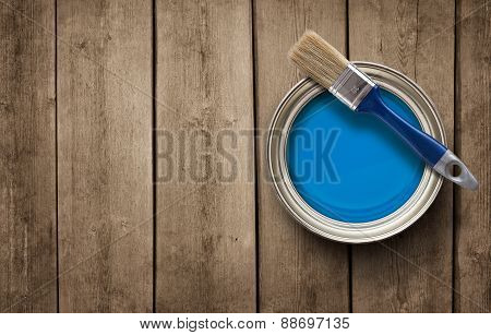Paint Can On The Old Wooden Floor