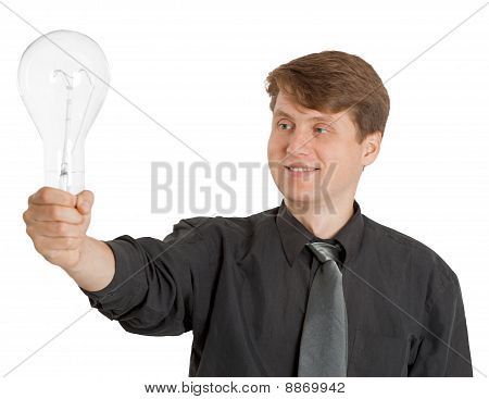 Satisfied Man Holding A Light Bulb