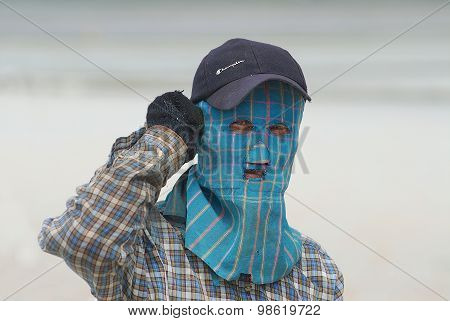 Portrait of a man wearing face mask at the salt farm in Huahin, Thailand.