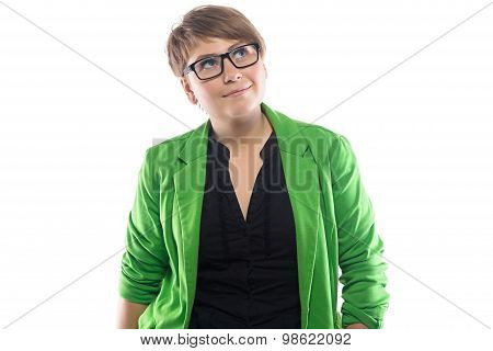 Photo of pudgy woman in green jacket, looking up