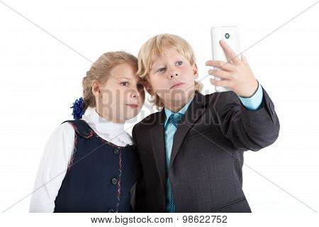 Cute Schoolchildren Making Selfie Picture With Smartphone Together, Isolated On White Background