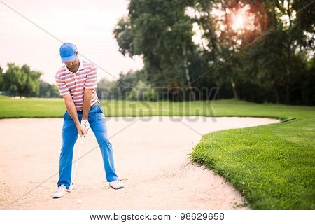 Golfer Taking A Bunker Shot