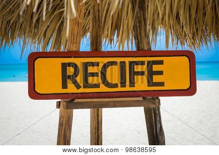 Recife sign with beach background