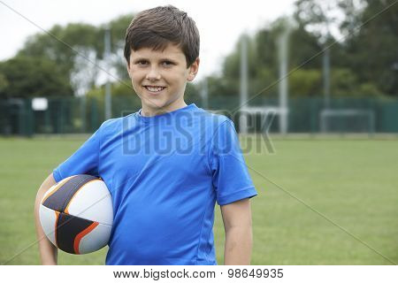 Portrait Of Boy Holding Ball On School Rugby Pitch