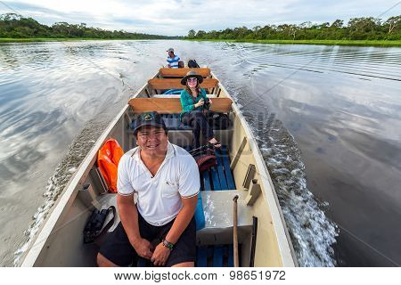 Guide And Tourist In A Boat
