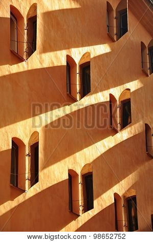 Side view of shaded windows of an old Stockholm apartment building with window shades half open poster