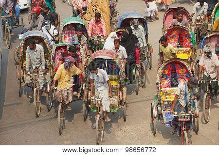 Rickshaws transport passengers in Dhaka, Bangladesh.