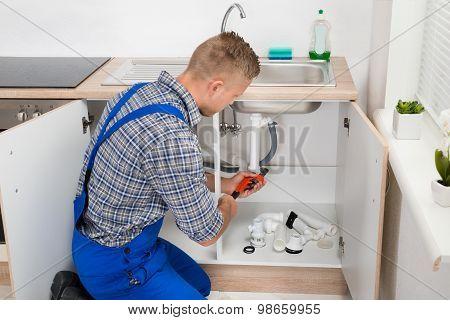 Plumber Fixing Sink Pipe
