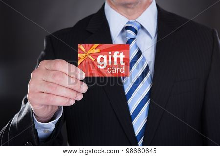 Close-up Of Businessman Holding Visiting Card