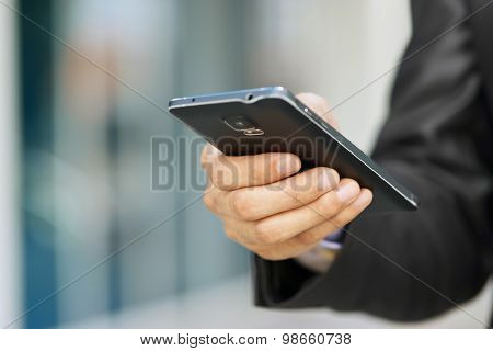 Business Man Holding Phablet Smartphone And Watching E-mail