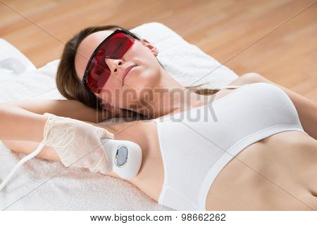 Beautician Removing Hair Of Woman With Epilator