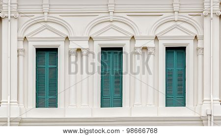 European Style Window With Green Shutters