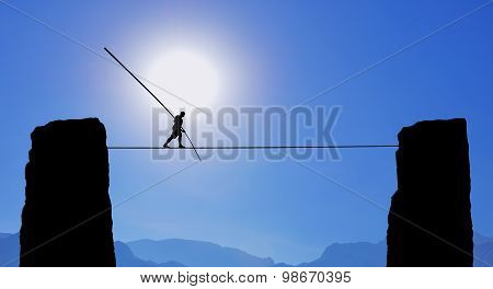 Tightrope Walker Balancing on The Rope