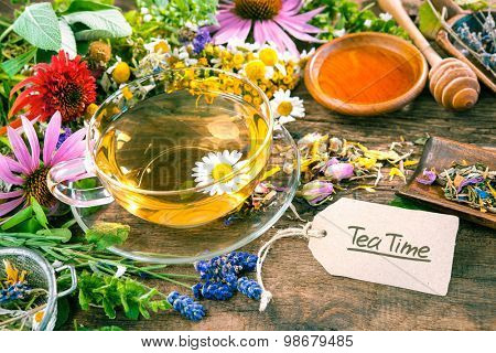 Cup of herbal tea with with honey and a tag