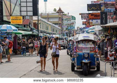 Tourists Walk Along Backpacker Haven Khao San Road And Tuktuk in Bangkok