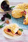 Pie with plums from yeast dough with cheese filling poster