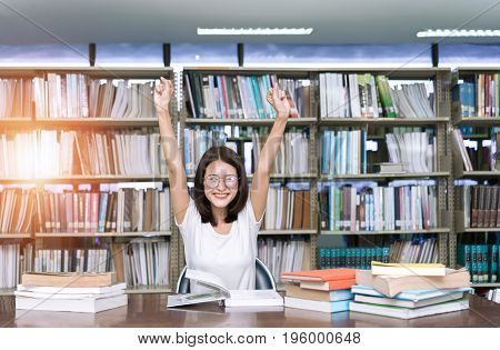 Young Student Girl  with Glasses Complete,Finish Reading book and Hard Exam in Classroom Lesson Education at Library