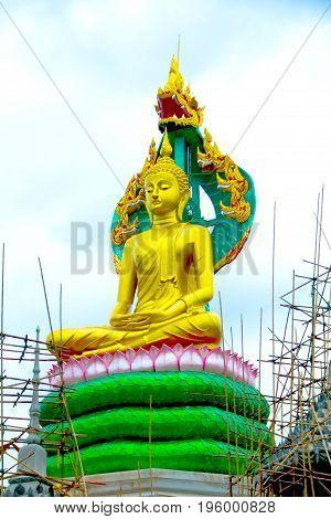 The beautiful lord buddha with king of naga (Pra jao yai sam phob) at Wat Mongkolgowitharam (Wat Huai Wang Nong)UbonratchathaniThailand.