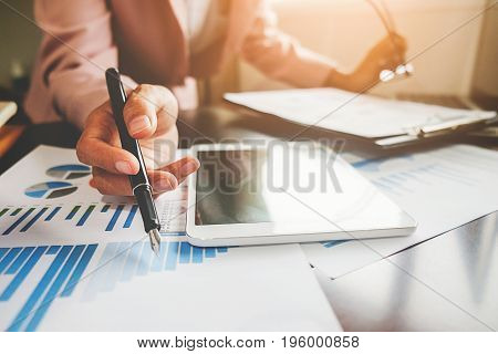 Business Woman Working At Office With Laptop And Documents On His Desk. Business Concept