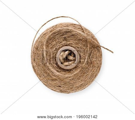 Coil of natural rope on white background. Close-up of twisted jute twine. Ecological handmade or gardening tool