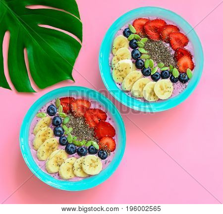 Berry smoothie bowls with chia seeds and pumpkin seeds view from above